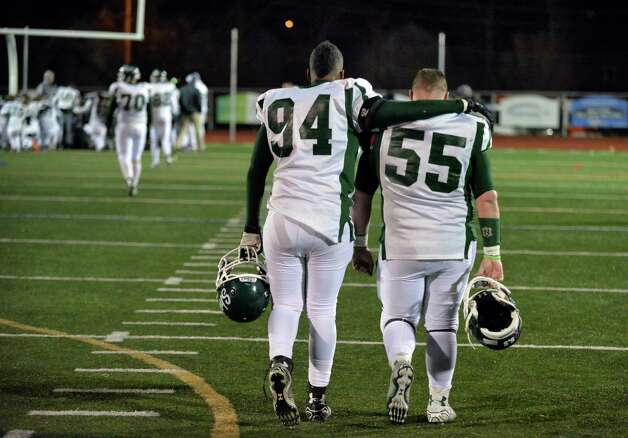 Shen's  #94 James Murray and #55 Dan Busold, right, leave the field after their overtime loss to Newburgh Free Academy in the Class AA state semifinal game at Dietz Stadium Friday Nov. 22, 2014, in Kingston, NY.  (John Carl D'Annibale / Times Union) Photo: John Carl D'Annibale / 00029583A