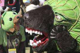 "Mascot called ""Melon Kuma"" strolls at the World Character Summit in Hanyu, Saitama prefecture, north of Tokyo, Saturday, Nov. 22, 2014. More than 400 characters representing local governments in Japan, called ""yuruchara,"" gathered for the event from all over the country. (AP Photo/Eugene Hoshiko)"