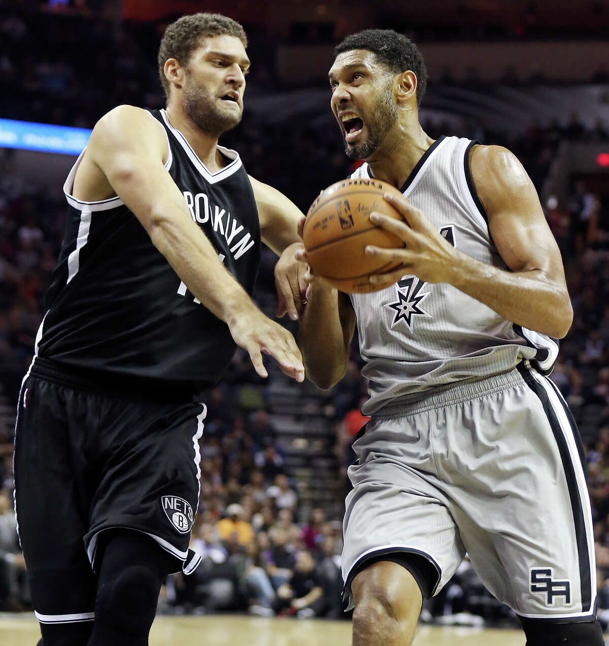 San Antonio Spurs' Tim Duncan drives around Brooklyn Nets' Brook Lopez during first half action Saturday Nov. 22, 2014 at the AT&T Center.