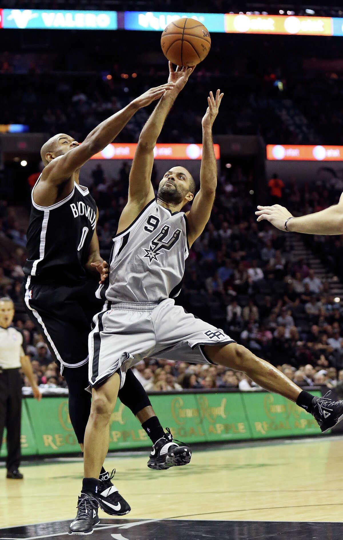 San Antonio Spurs' Tony Parker shoots against Brooklyn Nets' Jarrett Jack during first half action Saturday Nov. 22, 2014 at the AT&T Center.