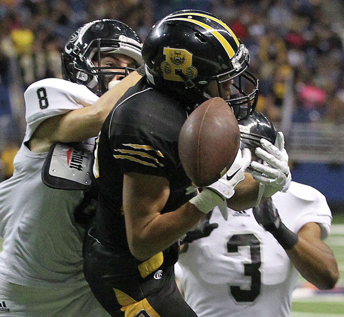 Tightly defended by Knighr defensive backs Mark Frankhouser (8) and Malik Perez, Bear receiver Dayne Thomas can't come up with a catch near the goal as Steele plays Brennan at the Alamodome in second round 6A high school Division I I playoff action on November 22, 2014.