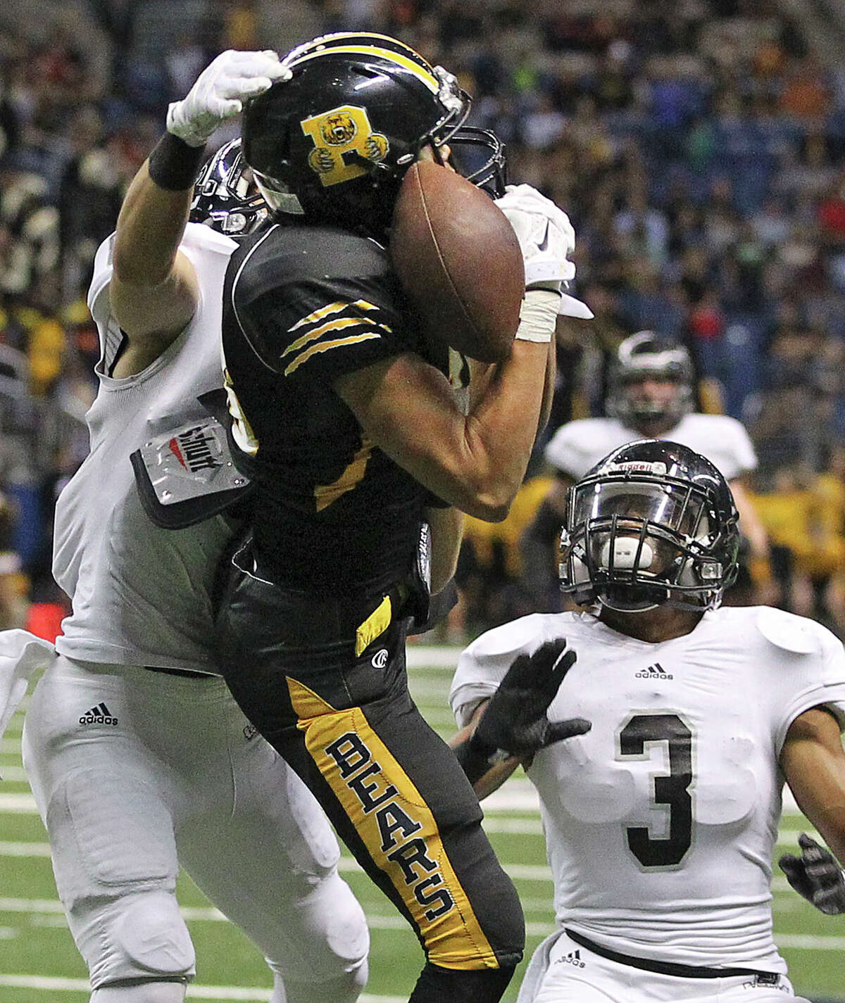 Bear receiver Dayne Thomas can't make the catch near the goal as defenders Mark Frankhouser (left) and Malik Perez pressure as Steele plays Brennan at the Alamodome in second round 6A high school Division I I playoff action on November 22, 2014.