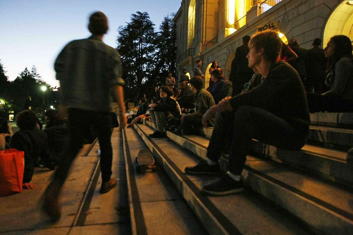 Students sit on the steps in front of Wheeler Hall on the UC Berkeley campus in Berkeley, Calif. Saturday, November 23, 2014 during a general assembly demonstration. UC Berkeley students are protesting the recently approved plan to raise tuition up to 28 percent over the next five years.