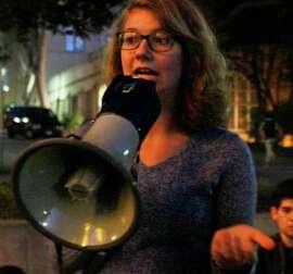 UC Berkeley student Maiya Monico speaks to a group of demonstrators in front of Wheeler Hall on the UC Berkeley campus in Berkeley on Saturday.