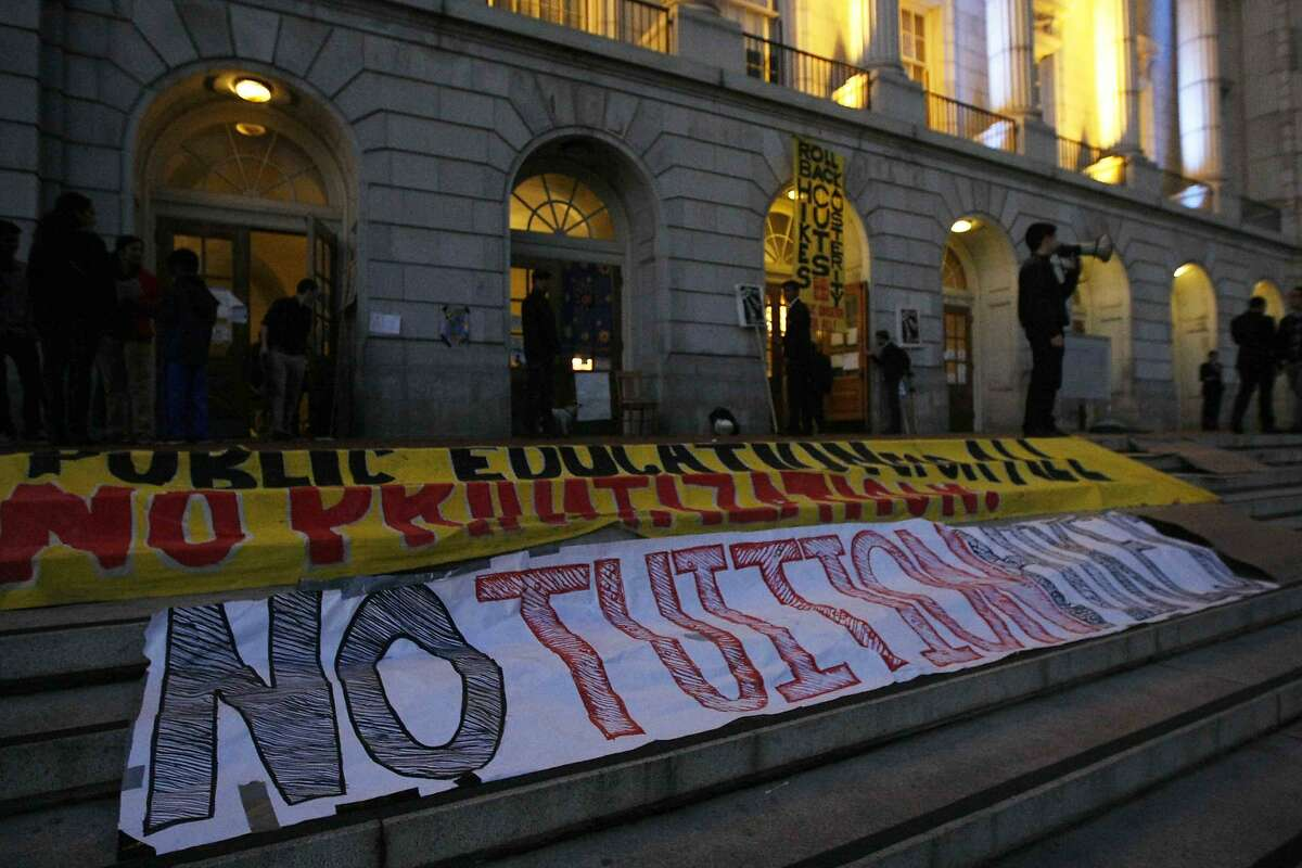 Banners are placed on the steps in front of Wheeler Hall during a demonstration on the UC Berkeley campus in Berkeley, Calif. Saturday, November 23, 2014. UC Berkeley students are protesting the recently approved plan to raise tuition up to 28 percent over the next five years.