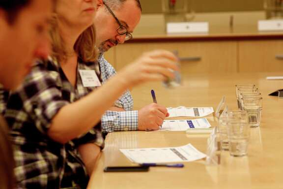 San Francisco Chronicle wine editor Jon Bonné takes notes during his tap water taste test at the San Francisco Public Utilities Commission. They included the city's current water, the 13.5 percent groundwater blend, bottled Arrowhead water and a duplicate of one of the samples.
