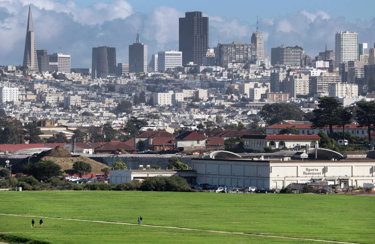 Construction of the Presidio Parkway project continues behind Crissy Field and the Sports Basement in San Francisco.
