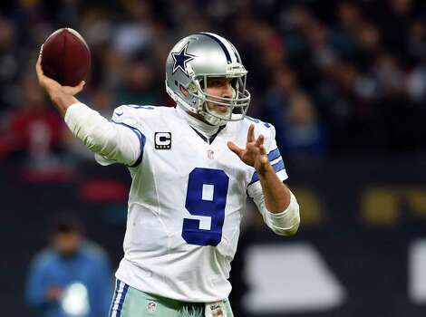 Dallas Cowboys quarterback Tony Romo (9) passes the ball against the Jacksonville Jaguars during the second half of an NFL football game at Wembley Stadium, London, Sunday, Nov. 9, 2014.  (AP Photo/Tim Ireland) Photo: Tim Ireland, STR / Associated Press / AP