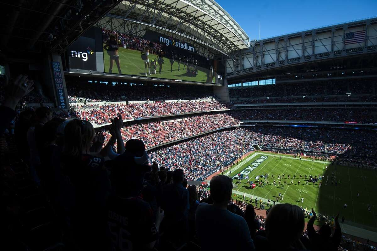 Houston Texans fans cheer as their team prepares to take the field before an NFL football game against the Cincinnati Bengals at NRG Stadium on Sunday, Nov. 23, 2014, in Houston. ( Smiley N. Pool / Houston Chronicle )