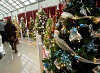 Visitors pass by decorated Christmas trees and vote on their favorites at the 12th annual Ann's Place Festival of Trees at the Matrix Conference & Banquet Center in Danbury. Sunday, Nov. 23, 2014