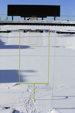 "Snow covers the seats and field at Ralph Wilson Stadium in Orchard Park, N.Y. Friday, Nov. 21, 2014. Snowed out in Buffalo, the Bills are heading to Detroit to play their ""home"" NFL football game against the New York Jets on Monday night, Nov. 24, 2014.(AP Photo/The Buffalo News, Harry Scull Jr.)  TV OUT; MAGS OUT; MANDATORY CREDIT; BATAVIA DAILY NEWS OUT; DUNKIRK OBSERVER OUT; JAMESTOWN POST-JOURNAL OUT; LOCKPORT UNION-SUN JOURNAL OUT; NIAGARA GAZETTE OUT; OLEAN TIMES-HERALD OUT; SALAMANCA PRESS OUT; TONAWANDA NEWS OUT  ORG XMIT: NYBUE309 Photo: Harry Scull Jr., AP / The Buffalo News"