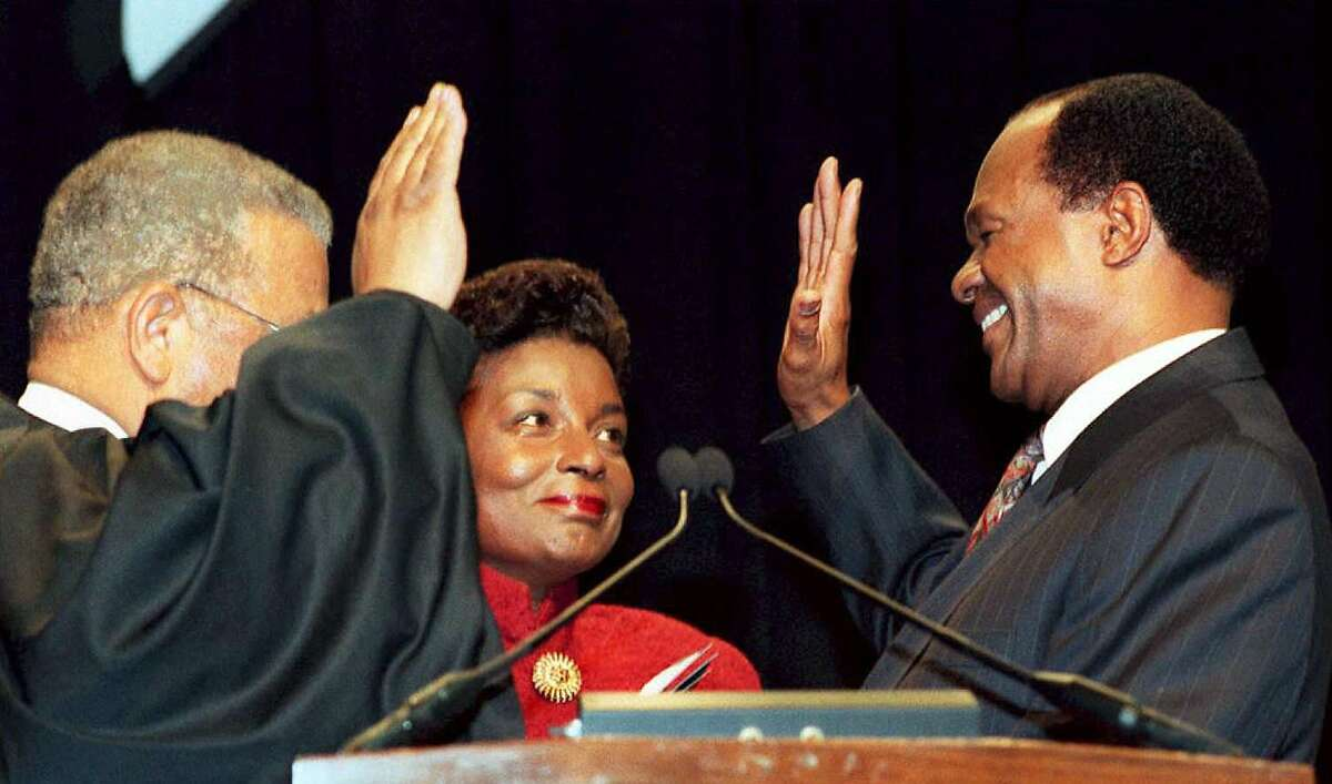 (FILES) This file photo taken on January 2, 1995 shows DC Mayor-elect Marion Barry (R) being sworn in by DC Superior Court Judge Eugene Hamilton (L) as his wife Cora Masters Barry (C) looks on in Washington DC, four years after being forced from the mayor's office in disgrace. Former Washington mayor Marion Barry, who left office in disgrace and went to prison on drug charges only to return for a fourth term, died at the age of 79 at a Washington hospital, a spokesperson said on November 23, 2014. AFP PHOTO / FILESRENAUD GIROUX/AFP/Getty Images