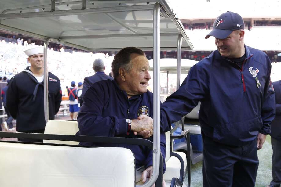 Houston Texans head coach Bill O'Brien shakes hands with former president George H.W. Bush before an NFL football game Cincinnati Bengals at NRG Stadium, Sunday, Nov. 23, 2014, in Houston.  ( Karen Warren / Houston Chronicle  ) Photo: Houston Chronicle