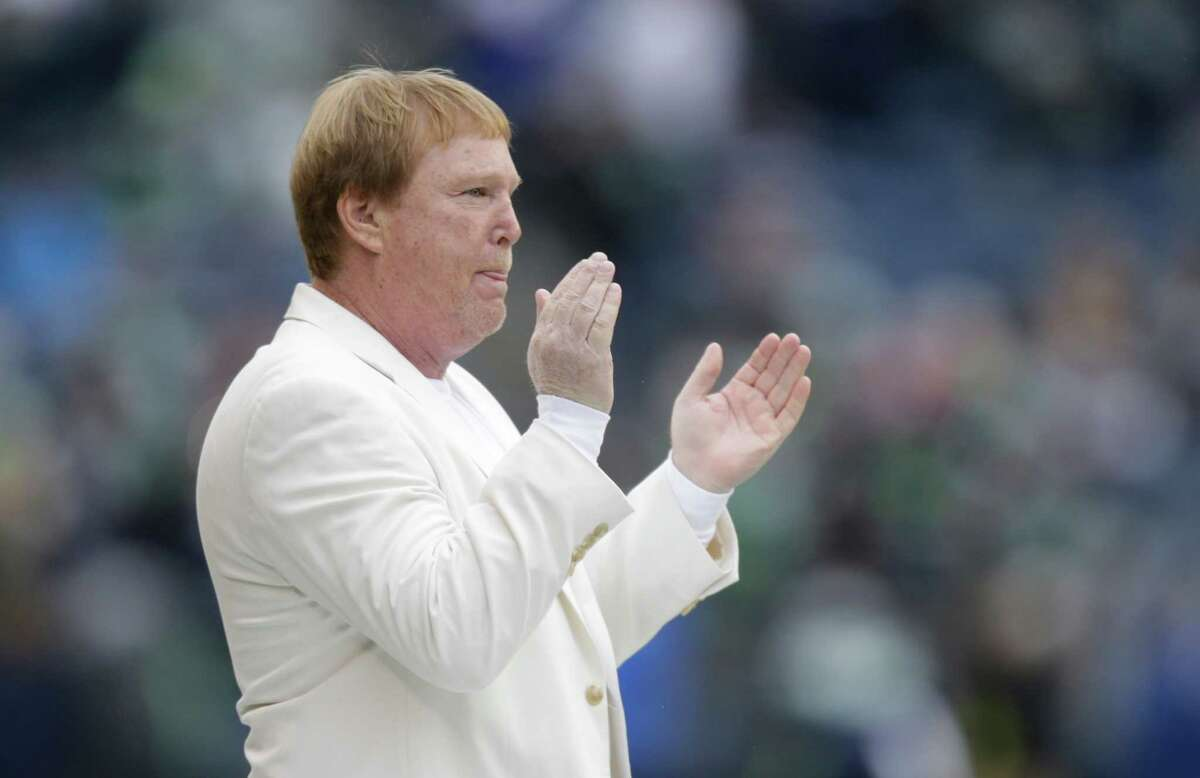 Oakland Raiders owner Mark Davis claps while watching warmups before an NFL football game between the Seattle Seahawks and the Oakland Raiders, Sunday, Nov. 2, 2014, in Seattle. (AP Photo/Stephen Brashear)
