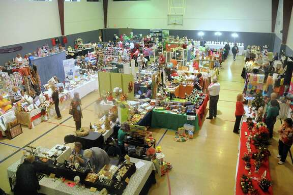 Booths fill the gymnasium at the 12th Annual Dickens Market, hosted by the Cypress Creek Christian Church and Community Center, 6823 Cypressword in Spring.
