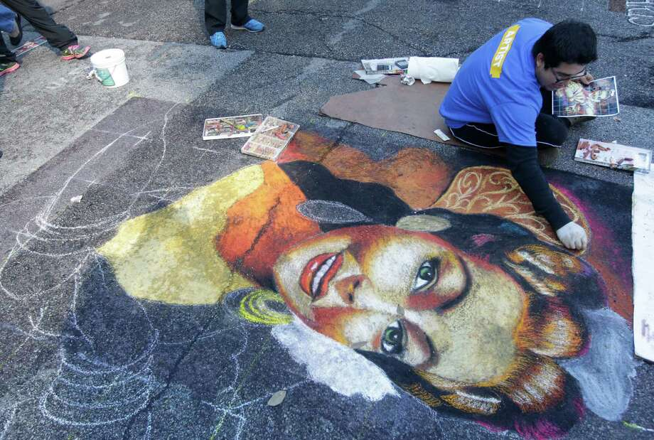 Jesus Carrizal works on his mural during the Via Colori Street Painting Festival on the streets around Hermann Square Park at City Hall Sunday, Nov. 23, 2014, in Houston. Photo: Melissa Phillip, Houston Chronicle / © 2014  Houston Chronicle