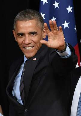 President Obama waves after speaking about his executive action on U.S. immigration policy at Del Sol High School on Friday.
