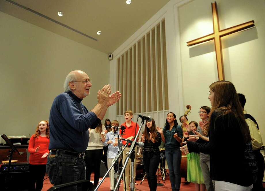 "Folk singerand activist Peter Yarrow, left, of Peter, Paul, and Mary, joins in on the group's hit ""If I Had a Hammer"" with the Newtown Youth Voices at the ""Within Our Reach- A Celebration of Our Commitment to Fulfilling the Sandy Hook Promise,"" concert at the Newtown Congregational Church in Newtown, Conn. on Sunday, November 23, 2014. Photo: Brian A. Pounds / Connecticut Post"