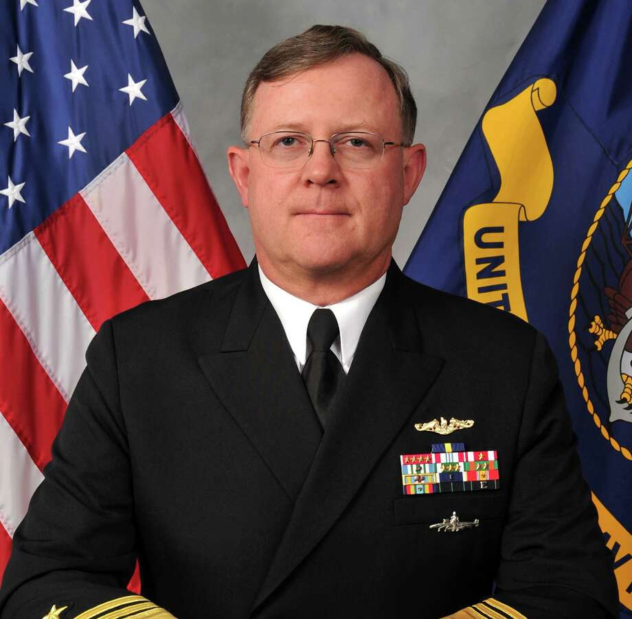 This image provided by the U.S. Navy shows Navy Vice Adm. Tim Giardina in a Nov. 11, 2011, photo. Giardina, fired last year as No. 2 commander of U.S. nuclear forces may have made his own counterfeit $500 poker chips with paint and stickers to feed a gambling habit that eventually saw him banned from an entire network of casinos, according to a criminal investigative report obtained by The Associated Press.   (AP Photo/U.S. Navy) Photo: Uncredited, HOPD / U.S. Navy