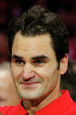 Swiss players Roger Federer shows his emotion after defeating France in the Davis Cup final at the Pierre Mauroy stadium in Lille, northern France, Sunday, Nov. 23, 2014.  Switzerland won 3-1  and wins the Davis Cup. (AP Photo/Christophe Ena) ORG XMIT: LIL172 Photo: Christophe Ena / AP