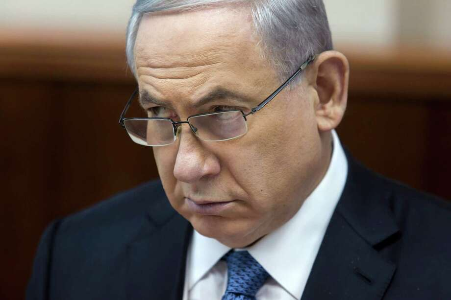 Israeli Prime Minister Benjamin Netanyahu listens during in his Cabinet meeting in his office in Jerusalem on Sunday, Nov. 23, 2014. At the start of the meeting, Netanyahu called for a bill that would revoke residency rights for Palestinians involved in attacks against Israelis. (AP Photo/Jim Hollander, Pool) Photo: Jim Hollander, POOL / POOL EPA