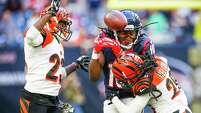 Cincinnati Bengals cornerback Terence Newman (23) and free safety Reggie Nelson (20) break up a pass intended for Houston Texans wide receiver DeAndre Hopkins (10) during the fourth quarter of an NFL football game at NRG Stadium on Sunday, Nov. 23, 2014, in Houston.