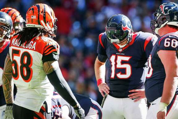 Houston Texans quarterback Ryan Mallett pauses at the line of scrimmage during the second quarter of an NFL football game against the Cincinnati Bengals at NRG Stadium, Sunday, Nov. 23, 2014, in Houston.