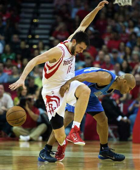 The Rockets' win over the Mavs on Saturday was of the scratching and clawing variety, much like Kostas Papanikolaou's encounter with Richard Jefferson. Photo: Smiley N. Pool, Staff / © 2014  Houston Chronicle