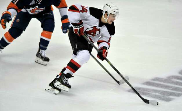 Reid Boucher with the Albany Devils brings the puck up the ice during their game against the Bridgeport Sound Tigers at the Times Union Center on Sunday, Nov. 23, 2014, in Albany, N.Y.  (Paul Buckowski / Times Union) Photo: Paul Buckowski / 00029286C