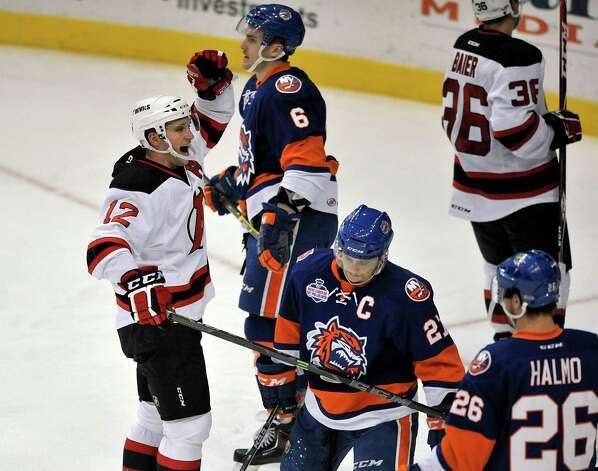 Tim Sestito, left, with the Albany Devils celebrates a goal by teammate, Eric Baier, right, during their game against the Bridgeport Sound Tigers at the Times Union Center on Sunday, Nov. 23, 2014, in Albany, N.Y.  (Paul Buckowski / Times Union) Photo: Paul Buckowski / 00029286C