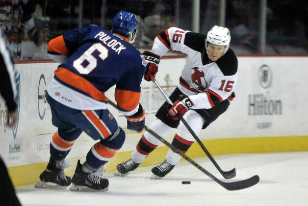 Chris McKelvie, right, with the Albany Devils brings the puck up the ice during their game against the Bridgeport Sound Tigers at the Times Union Center on Sunday, Nov. 23, 2014, in Albany, N.Y.  (Paul Buckowski / Times Union) Photo: Paul Buckowski / 00029286C