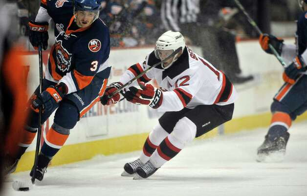 Tim Sestito, right, with the Albany Devils tries to steal the puck from Andrey Pedan during their game against the Bridgeport Sound Tigers at the Times Union Center on Sunday, Nov. 23, 2014, in Albany, N.Y.  (Paul Buckowski / Times Union) Photo: Paul Buckowski / 00029286C