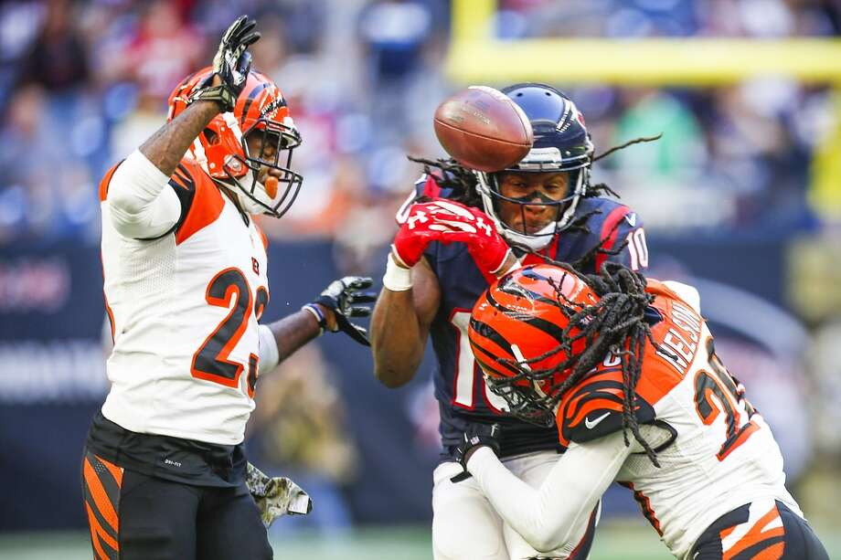 Cincinnati Bengals cornerback Terence Newman (23) and free safety Reggie Nelson (20) break up a pass intended for Houston Texans wide receiver DeAndre Hopkins (10) during the fourth quarter of an NFL football game at NRG Stadium on Sunday, Nov. 23, 2014, in Houston. ( Brett Coomer / Houston Chronicle ) Photo: Brett Coomer, Houston Chronicle