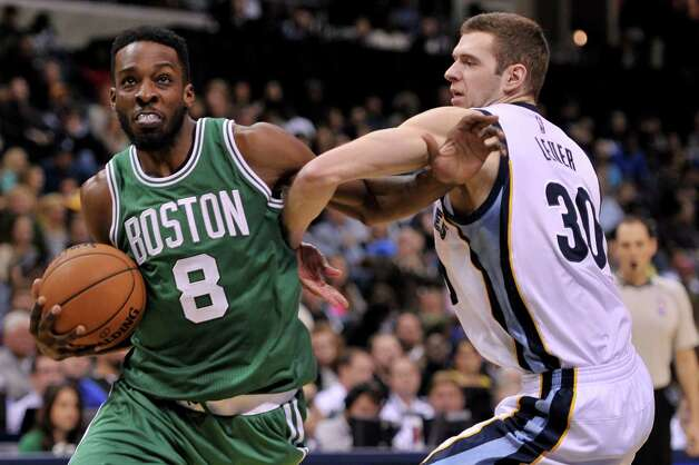 Boston Celtics forward Jeff Green (8) tries to get past Memphis Grizzlies forward Jon Leuer (30) in the second half of an NBA basketball game Friday, Nov. 21, 2014, in Memphis, Tenn. The Grizzlies beat the Celtics 117-100. (AP Photo/Brandon Dill) ORG XMIT: TNBD115 Photo: Brandon Dill / FR171250 AP