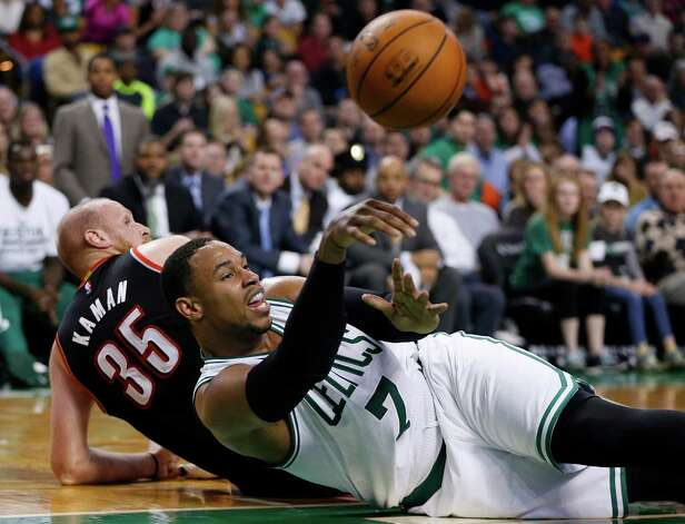Boston Celtics' Jared Sullinger (7) passes off after battling Portland Trail Blazers' Chris Kaman (35) for a loose ball in the fourth quarter of an NBA basketball game in Boston, Sunday, Nov. 23, 2014. The Portland Trail Blazers won 94-88. (AP Photo/Michael Dwyer) ORG XMIT: MAMD109 Photo: Michael Dwyer / AP