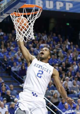 Kentucky's Aaron Harrison gets an uncontested dunk during the first half of an NCAA college basketball game against Montana State, Sunday, Nov. 23, 2014, in Lexington, Ky. (AP Photo/James Crisp) ORG XMIT: KYJC106 Photo: James Crisp / FR6426 AP
