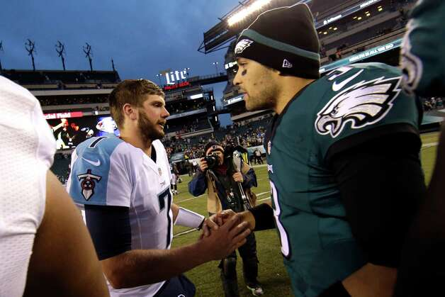 Tennessee Titans' Zach Mettenberger, left, and Philadelphia Eagles' Mark Sanchez meet after an NFL football game, Sunday, Nov. 23, 2014, in Philadelphia. Philadelphia won 43-24. (AP Photo/Michael Perez) ORG XMIT: PXE124 Photo: Michael Perez / FR168006 AP