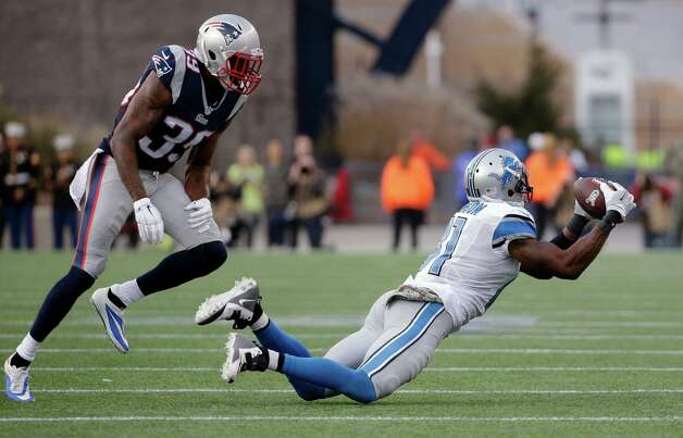 Detroit Lions wide receiver Calvin Johnson (81) catches a pass in front of New England Patriots cornerback Brandon Browner (39) in the second half of an NFL football game Sunday, Nov. 23, 2014, in Foxborough, Mass. (AP Photo/Steven Senne) ORG XMIT: FBO116 Photo: Steven Senne / AP
