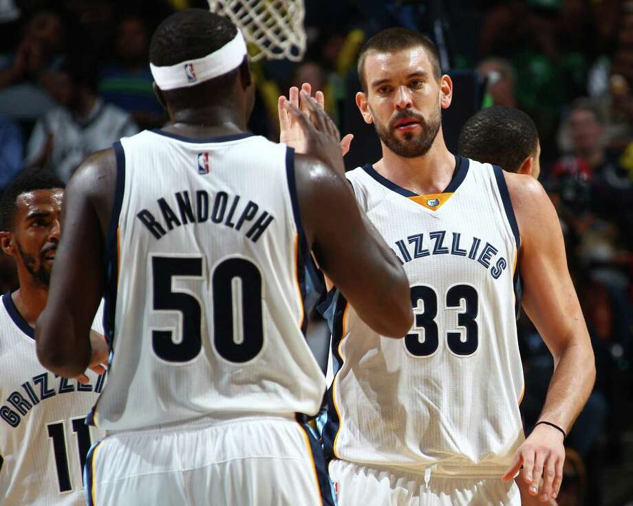 The Memphis Grizzlies' Zach Randolph (50) and Marc Gasol (33) celebrate a Grizzlies lead as they head into a time out against the Boston Celtics at FedExForum in Memphis, Tenn., on Friday, Nov. 21, 2014. The Grizzlies won, 117-100. (Nikki Boertman/The Commercial Appeal) Photo: Nikki Boertman, MBR / The Commercial Appeal