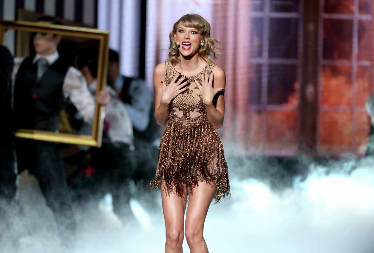 Taylor Swift performs on stage at the 42nd annual American Music Awards at Nokia Theatre L.A. Live on Sunday, Nov. 23, 2014, in Los Angeles.