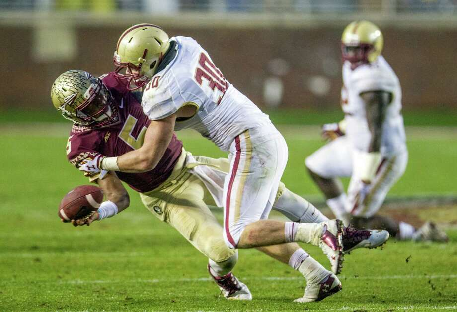 It was another stressful Saturday for Florida State quarterback Jameis Winston, left, as an inspired effort by Boston College players such as Mike Strizak made the Seminoles work hard for their 27th consecutive victory. Photo: Mark Wallheiser, FRE / FR171224 AP