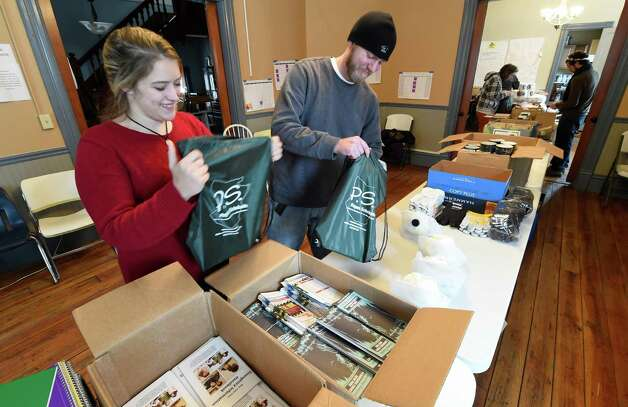 Jillian Kubiak, volunteer director is assisted by Matt Ladd of AmeriCorps VISTA volunteer of SALT (Schoharie Area Long Term, Inc.) assemble emergency ready kits Friday morning Nov. 21, 2014 in Schoharie, N.Y. The kits are to be distributed to homebound people, including single mothers, the elderly, and those in the rural areas.  (Skip Dickstein/Times Union) Photo: SKIP DICKSTEIN / 00029586A