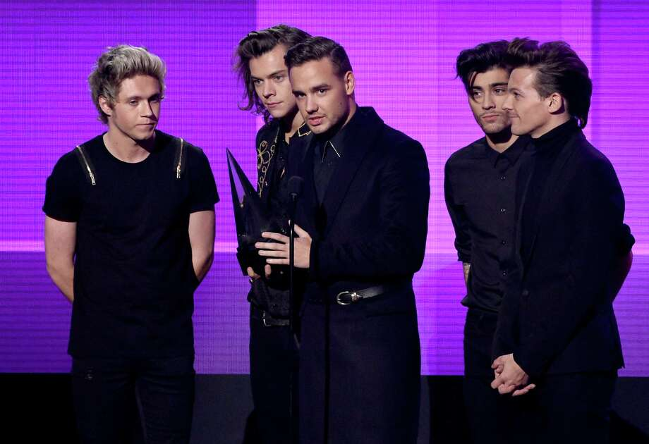 Members of One Direction accept the Artist of the Year award onstage at the 2014 American Music Awards in Los Angeles Sunday night. Photo: Kevin Winter, Staff / 2014 Getty Images