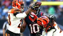 Cincinnati Bengals cornerback Terence Newman (23) and free safety Reggie Nelson (20) break up a pass intended for Houston Texans wide receiver DeAndre Hopkins (10) during the fourth quarter of an NFL football game at NRG Stadium on Sunday, Nov. 23, 2014, in Houston. ( Brett Coomer / Houston Chronicle )