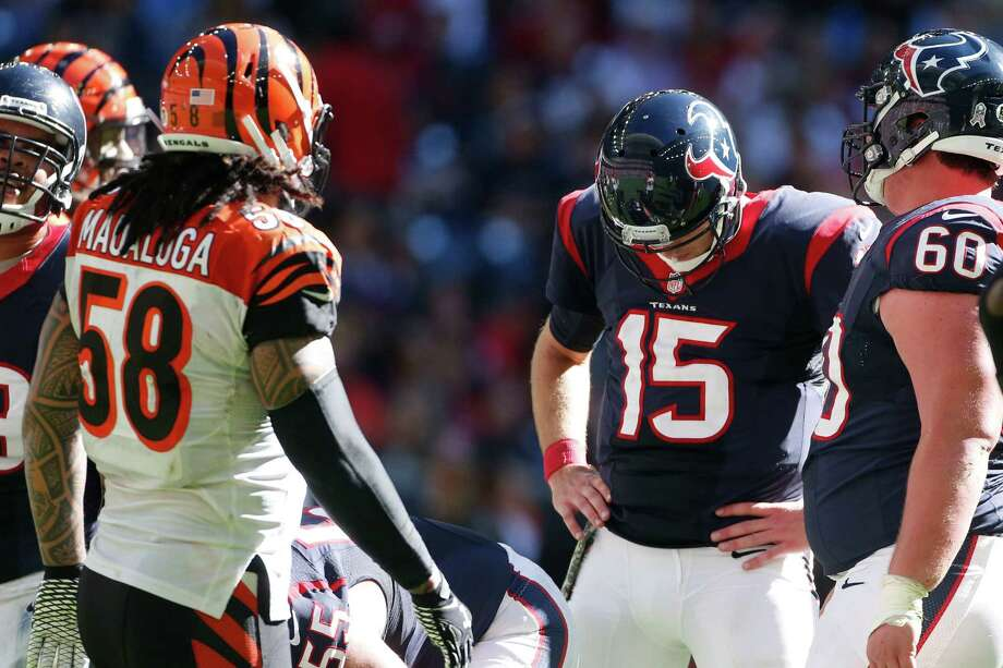 Texans quarterback Ryan Mallett could barely watch Sunday during a tough performance in which he threw no touchdown passes. Photo: Karen Warren, Staff / © 2014 Houston Chronicle