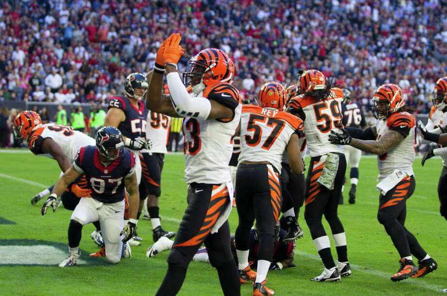 Cincinnati cornerback Terence Newman (23) leads the cheers after the Bengals' Geno Atkins tackled Texans running back Alfred Blue in the end zone for a safety in the second quarter. Photo: Brett Coomer, Staff / © 2014  Houston Chronicle