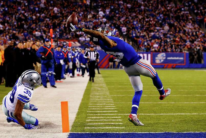 EAST RUTHERFORD, NJ - NOVEMBER 23:  Odell Beckham #13 of the New York Giants scores a touchdown in t