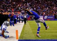 EAST RUTHERFORD, NJ - NOVEMBER 23:  Odell Beckham #13 of the New York Giants scores a touchdown in the second quarter against the Dallas Cowboys at MetLife Stadium on November 23, 2014 in East Rutherford, New Jersey.  (Photo by Al Bello/Getty Images) ORG XMIT: 507869247