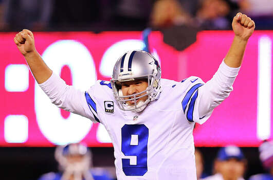 Tony Romo celebrates throwing the game winning touchdown pass in the fourth quarter against the New York Giants at MetLife Stadium. The Cowboys defeated the Giants 31-28. Photo: Elsa, Staff / Getty Images / 2014 Getty Images