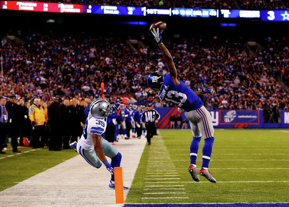 Sunday night's entertaining game featured a comeback by the Cowboys and a play to remember by the Giants' Odell Beckham Jr., who had a spectacular touchdown catch against Brandon Carr in the second quarter. Photo: Al Bello, Staff / 2014 Getty Images